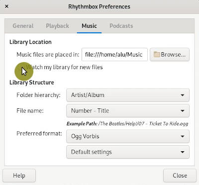 watch library for new files option in Rhythmbox